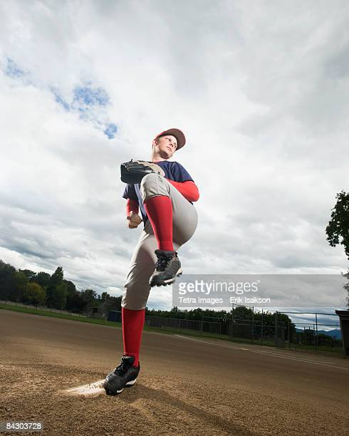 Baseball pitcher getting ready to throw ball