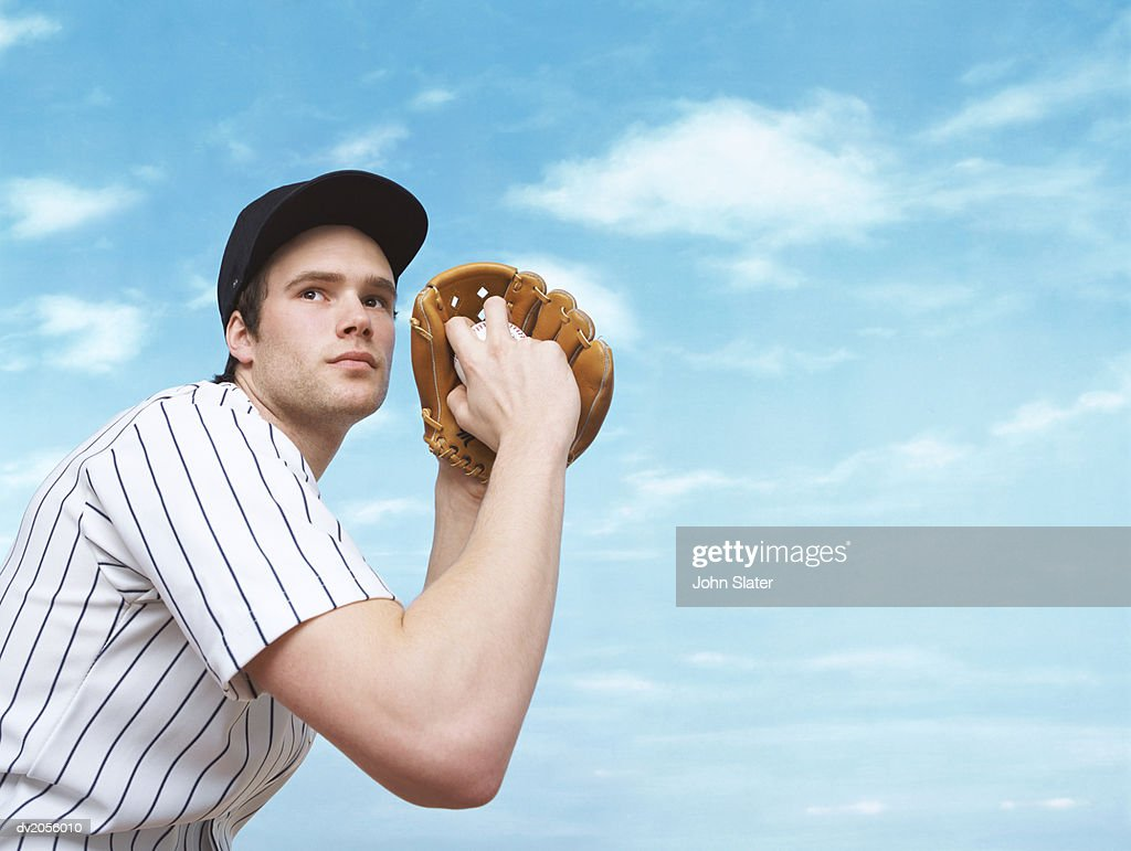 Baseball Pitcher Preparing to Pitch a Baseball : Stock Photo
