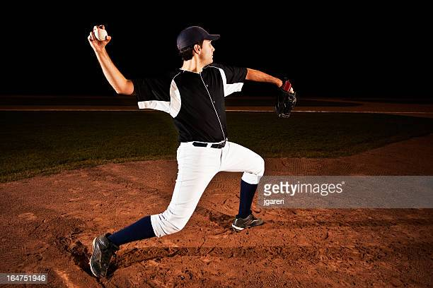 a baseball pitcher preparing to throw a ball - pitcher stockfoto's en -beelden