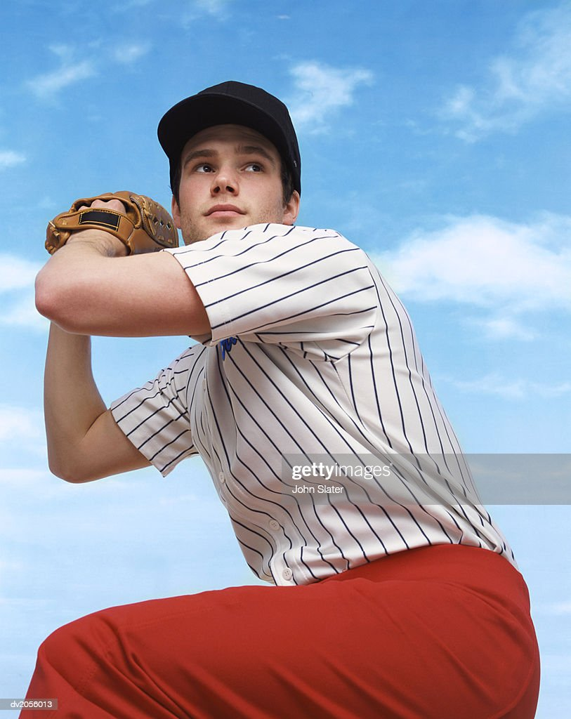 Baseball Pitcher Preparing to Throw a Baseball : Stock Photo