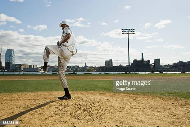baseball pitcher standing on one leg - baseball pitcher stock pictures, royalty-free photos & images