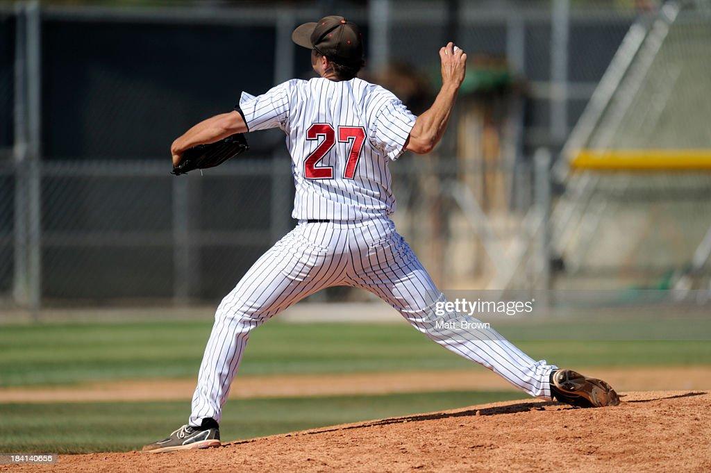 Baseball pitcher throwing the ball : Stock Photo