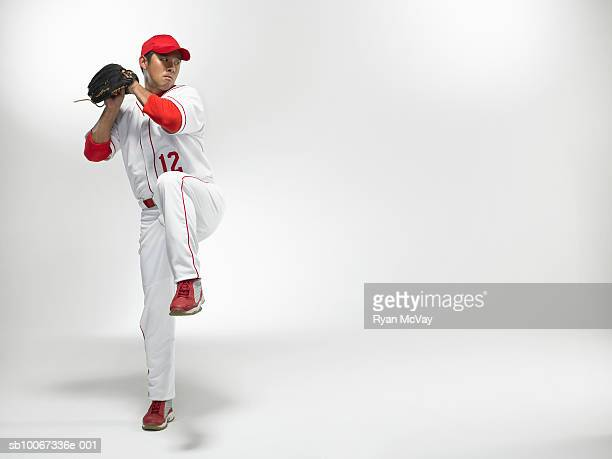 baseball pitcher winding up, studio shot - baseball pitcher stock pictures, royalty-free photos & images