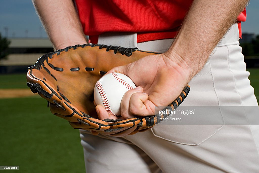 Baseball pitcher with glove and ball : Stock Photo