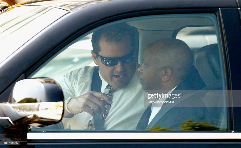 Baseball pitching star Roger Clemens (L) sits in his car after leaving U.S. District Court following his arraignment, on August 30, 2010 in Washington, DC. Seven-time Cy Young Award winner Clemens, who plead not-guilty, was charged with making false statements, perjury and obstructing Congress when he testified in a February 2008 inquiry by the House Oversight and Government Affairs Committee on his alleged use of performance enhancing drugs.