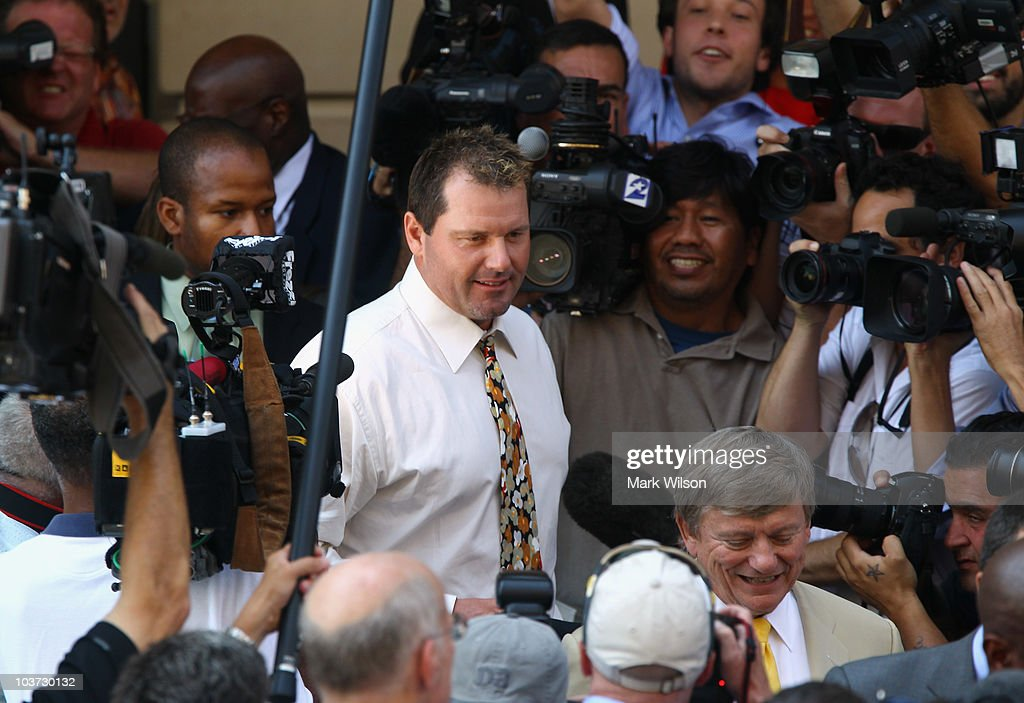 Baseball pitching star Roger Clemens (C) walks out of the U.S. District Court after his arraignment, on August 30, 2010 in Washington, DC. Clemens who plead not-guilty was charged with making false statements, perjury and obstructing Congress when he testified in a February 2008 inquiry by the House Oversight and Government Affairs Committee on his alleged use of performance enhancing drugs.
