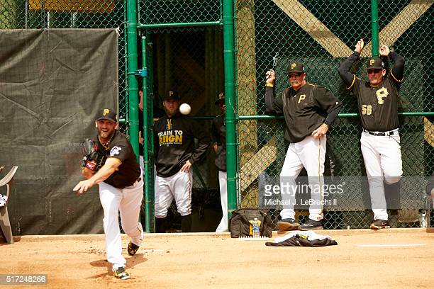 Pittsburgh Pirates pitching coach Ray Searage watching Jonathon Niese warming up in bullpen before spring training game vs Toronto Blue Jays at...