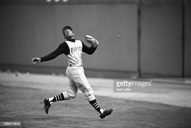 Pittsburgh Pirates Roberto Clemente in action fielding pop fly vs St Louis Cardinals at Civic Center Busch Memorial Stadium St Louis MO...