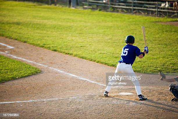 Baseball player about to hit a home run