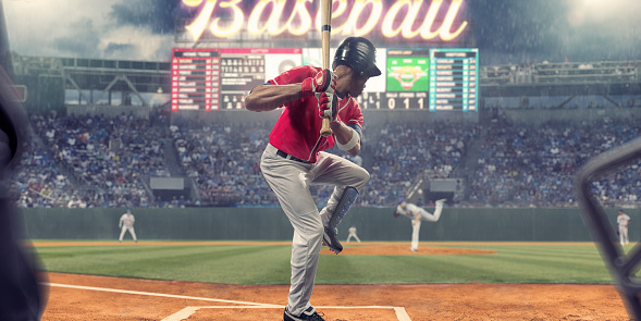 Baseball Player About To Strike Ball During Baseball Game 942628008