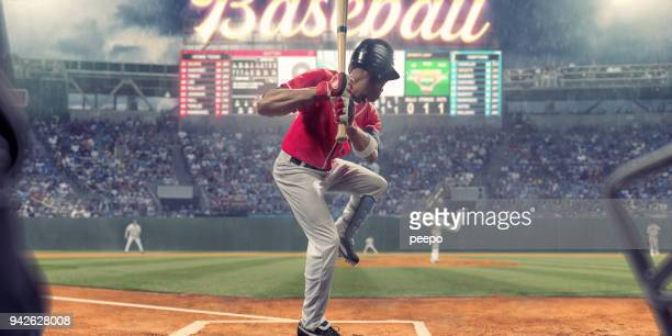 baseball player about to strike ball during baseball game - baseball player stock pictures, royalty-free photos & images
