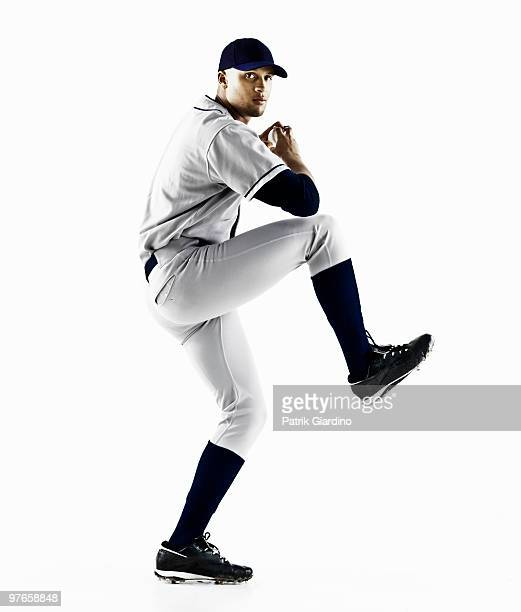baseball player about to throw a pitch - baseball player stock pictures, royalty-free photos & images