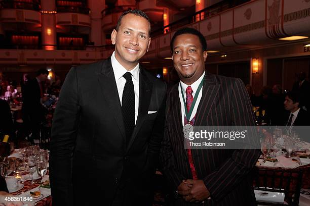 Baseball player Alex Rodriguez and former baseball player Pedro Martinez attends the 29th Annual Great Sports Legends Dinner to benefit The...