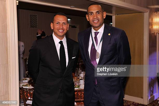 Baseball player Alex Rodriguez and former basketball player Grant Hill attend the 29th Annual Great Sports Legends Dinner to benefit The Buoniconti...