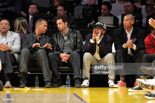 Baseball player Alex Rodriguez of the New York Yankees director Spike Lee and former basketball player Reggie Miller attend a game between the New...