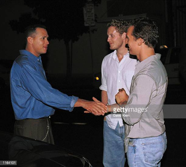 Baseball player Alex Rodriguez shakes actor Matthew McConaughey's hand outside the Las Palmas club September 26 2001 in Hollywood CA