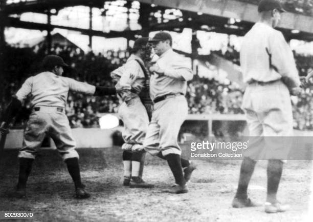 Baseball player Babe Ruth on the field hits his first home run of the season on April 21 1924 in his New York Yankees uniform in New York New York