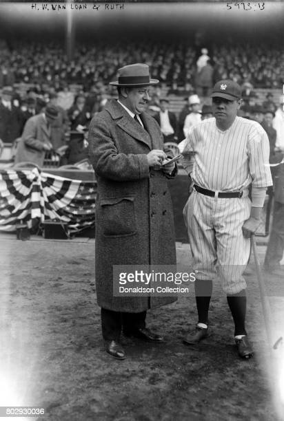 Baseball player Babe Ruth on the field in his New York Yankees uniform with screen playwright HH Van Loan in 1921 in New York New York