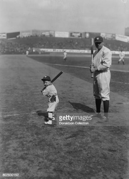 Baseball player Babe Ruth on the field in his New York Yankees uniform with the mascot in 1922 in New York New York