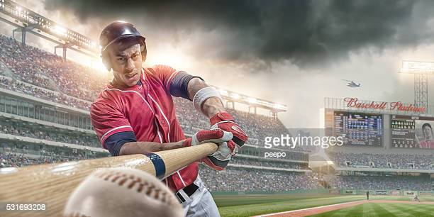 baseball player batting ball in close up in baseball arena - baseball player stock pictures, royalty-free photos & images