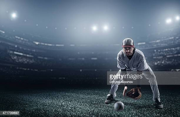 Baseball player catching a ball in stadium
