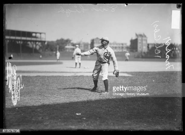 Baseball player Chick Fraser pitcher for the Chicago Cubs warms up at the West Side Grounds Chicago Illinois 1908
