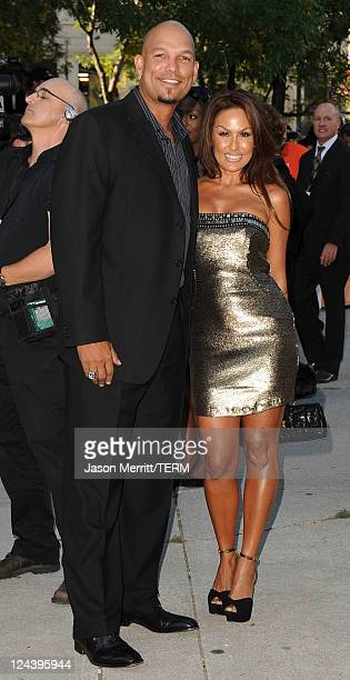 Baseball Player David Justice and wife arrive at Moneyball Premiere at Roy Thomson Hall during the 2011 Toronto International Film Festival on...
