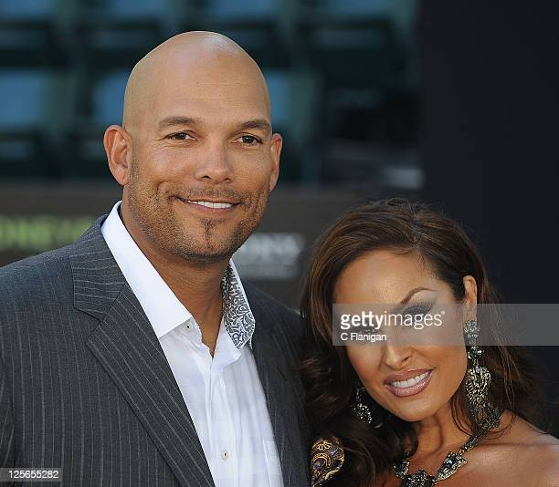 Baseball Player David Justice and wife Rebecca VillalobosJustice attend the Moneyball Premiere at The Paramount Theatre on September 19 2011 in...