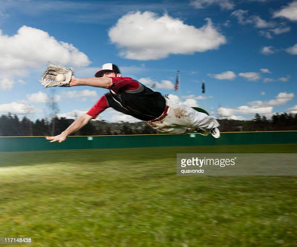 baseball player diving for catch, flying in air, copy space - catching stock pictures, royalty-free photos & images