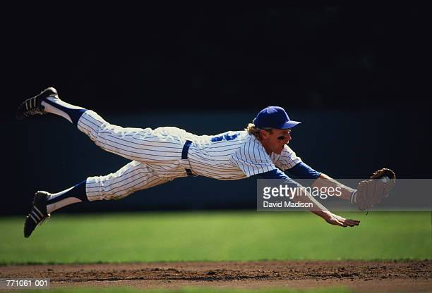 baseball player diving to catch ball - diving to the ground stock pictures, royalty-free photos & images