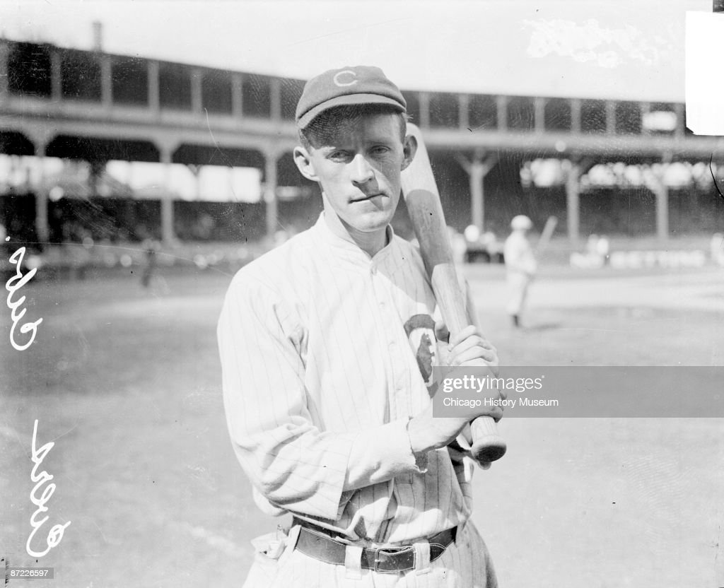 Baseball player Evers, second baseman of the Chicago Cubs, holding a baseball bat on the field at West Side Grounds, Chicago, IL, 1912. From the Chicago Daily News collection.