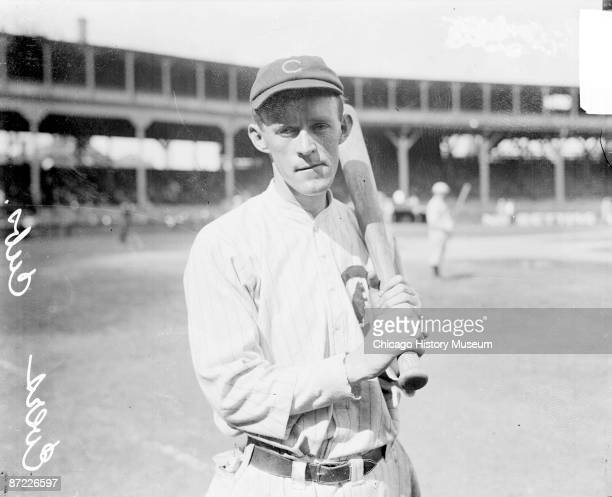 Baseball player Evers second baseman of the Chicago Cubs holding a baseball bat on the field at West Side Grounds Chicago IL 1912 From the Chicago...