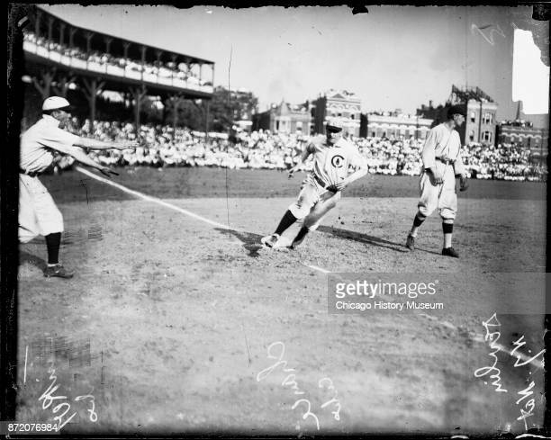 Baseball player Frank Chance of the Chicago Cubs rounds third base during a game against the New York Giants at West Side Grounds Chicago Illinois...