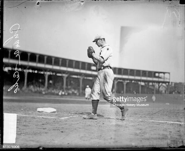 Baseball player Frank Chance of the Chicago Cubs walks behind first base on the field at West Side Grounds Chicago Illinois 1908