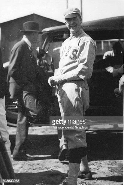 Baseball player Grover Cleveland Alexander of the Chicago Cubs stands near a car during spring training Catalina Island California 1923