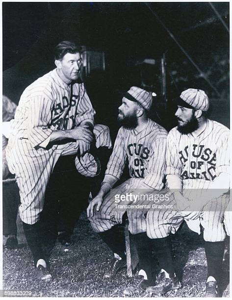 Baseball player Grover Cleveland Alexander talks with teammates on the barnstorming House of David team 1931