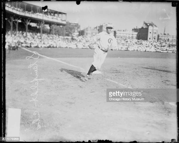 Baseball player Harry Steinfeldt of the Chicago Cubs rounds third base during a game at West Side Grounds Chicago Illinois 1908