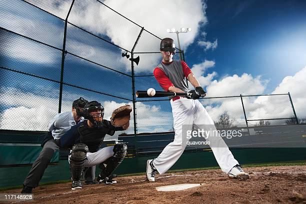 Athletic Baseball Player Hitting Ball with Catcher and Umpire, Copyspace