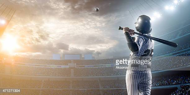 baseball player hitting a ball in stadium - baseball player stock pictures, royalty-free photos & images