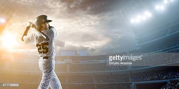 baseball player hitting a ball in stadium - batting stock pictures, royalty-free photos & images