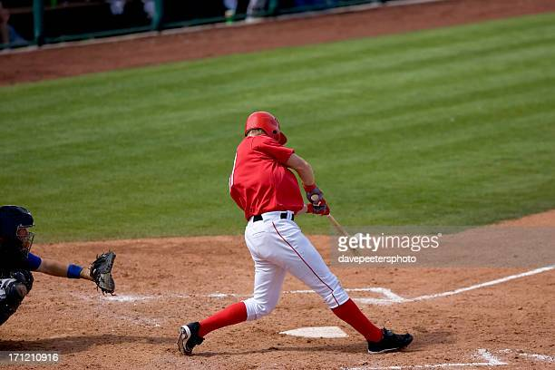 Baseball player hitting ball during a game