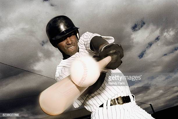 baseball player hitting ball - batting sports activity stock pictures, royalty-free photos & images