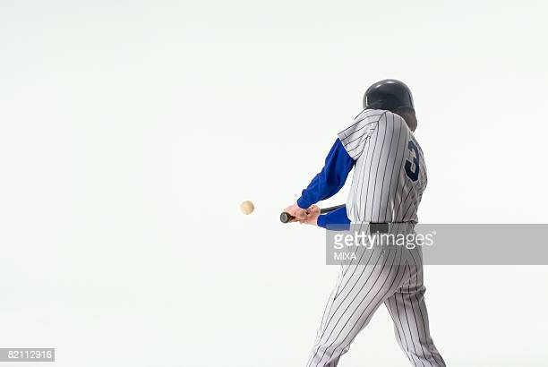 baseball player hitting ball - batting sports activity stock photos and pictures