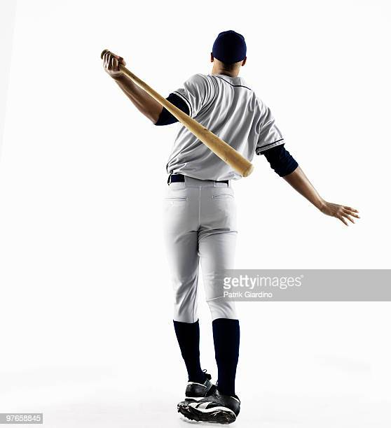 Baseball Player hitting home run from behind