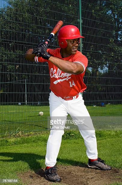 A baseball player holding a baseball bat