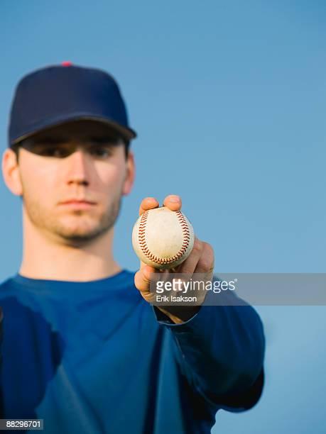 Baseball player holding ball