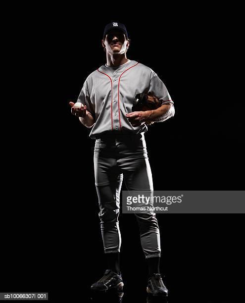 Baseball player holding ball, portrait