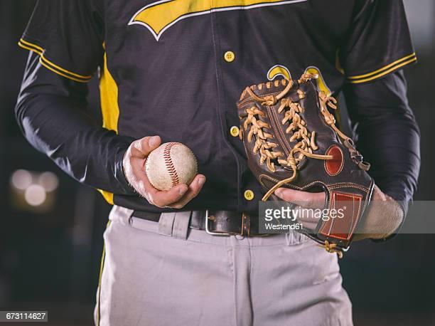 baseball player holding baseball - キャッチャーミット ストックフォトと画像
