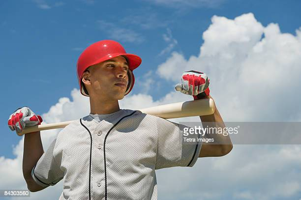 baseball player holding bat - baseball uniform stock pictures, royalty-free photos & images