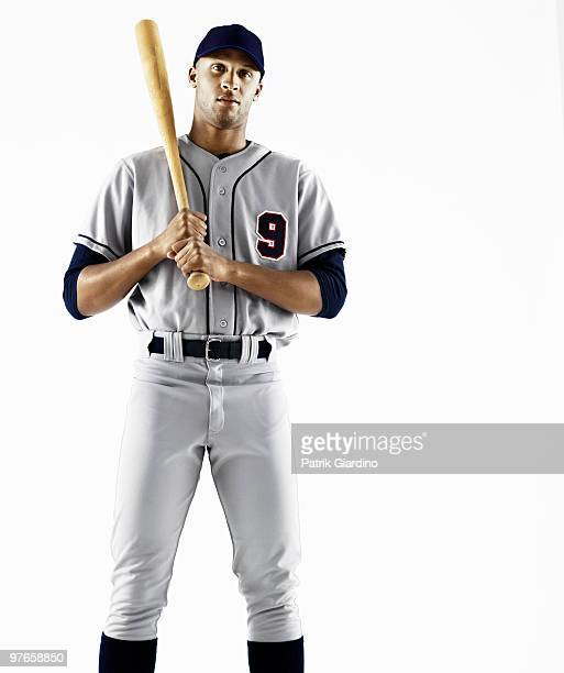 baseball player holding bat - baseball player stock pictures, royalty-free photos & images
